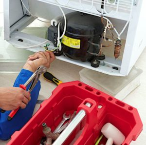 29868210 - repairman makes refrigerator appliance troubleshooting and maintenance works