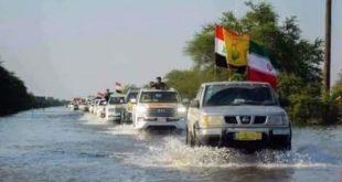 שיירת מיליציית אלחשד אלשעבי העיראקית מגיעה לאזורים שנפגעו מהשיטפונות באיראן: